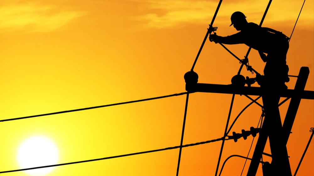 Line man on utility pole